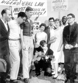 Freedom Riders are welcomed home to Wold-Chamberlain Field in the Twin Cities. From left in foreground: Marv Davidov, Zev Aelony, David Morton, Eugene Uphoff (with guitar), Claire O'Connor and Robert Baum. (Pioneer Press, File)