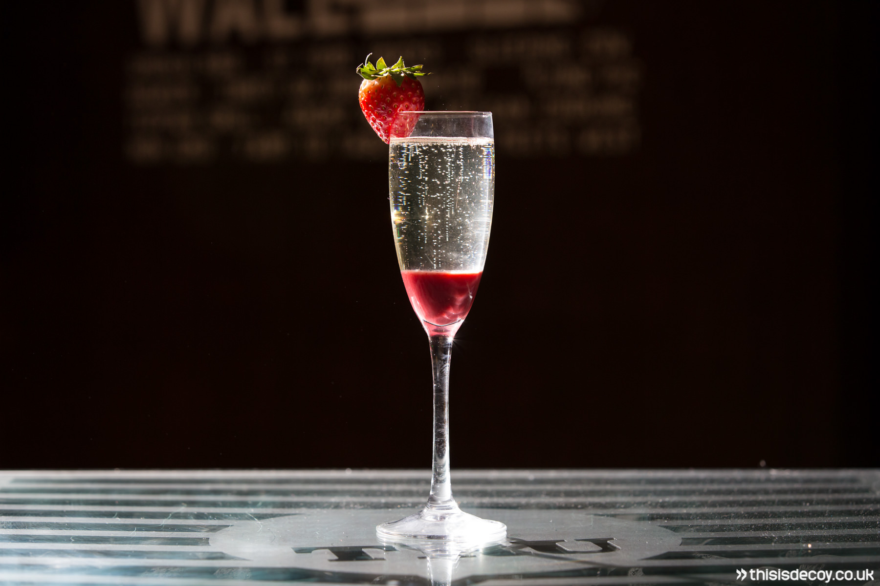 champange cocktail lit with flash