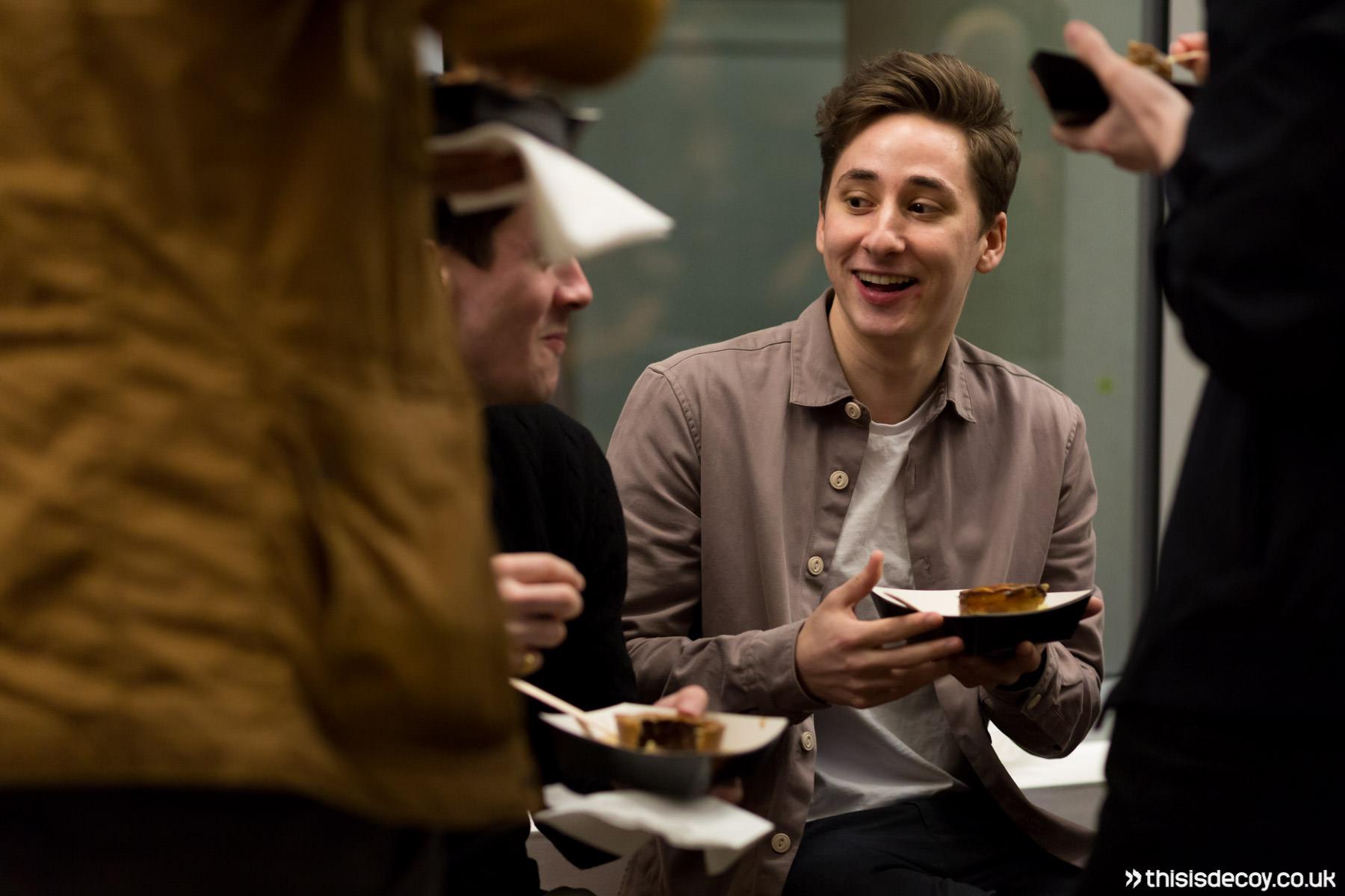 guys enjoying food with telephoto