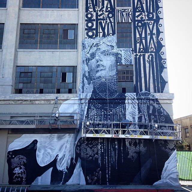 @ironeyeretna  hired me and @ricardoestrada323  to paint this extremely technical 3story portrait a few months back. It can be found on 7th and alameda . #evanskrederstu #ricardoestrada  #workforhire  #losangeles #mural  #losangelesmural  painting #americanapperal #retna  #theartsdistrict