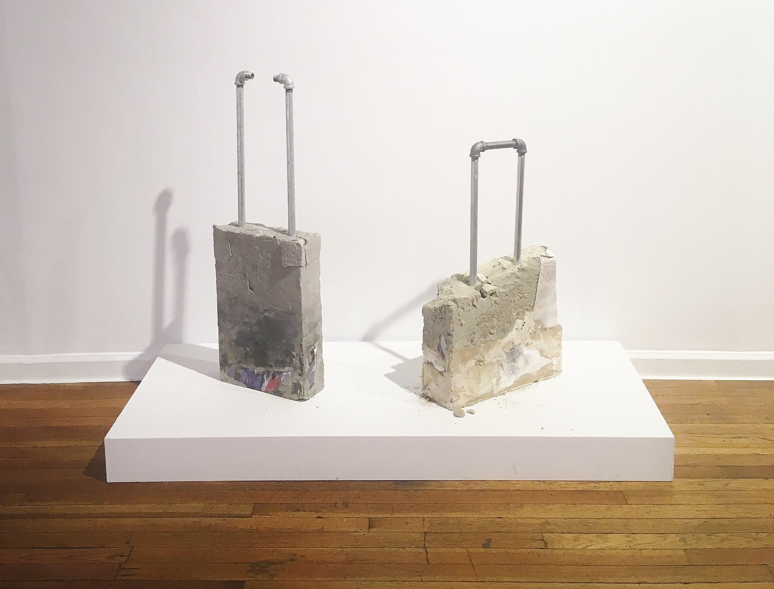 Luggage & Luggage II (2017). Archival print, metal rods in concrete.