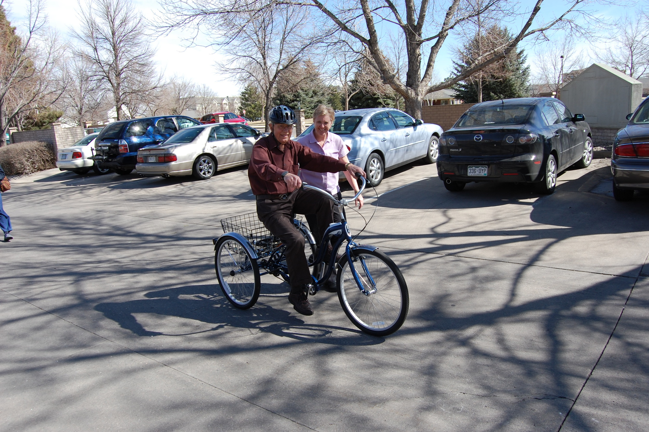 Individual with Parkinson's Disease learning how to ride the clinic bicycle.