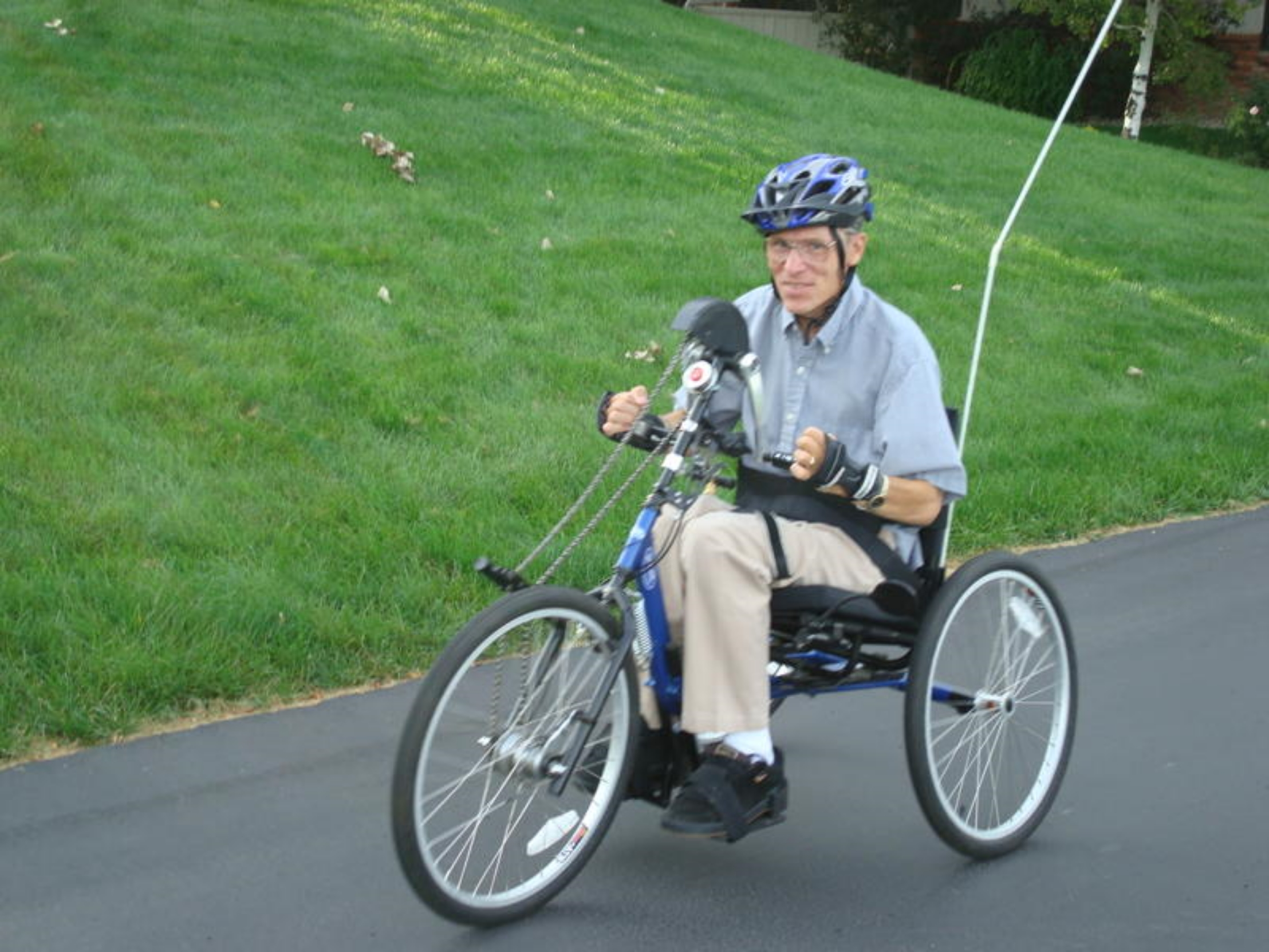 Individual that had a C3/C4 spinal cord injury enjoying a ride on his adaptive bicycle.
