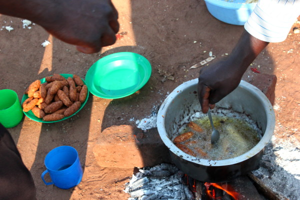 Making and cooking Soya sausages.