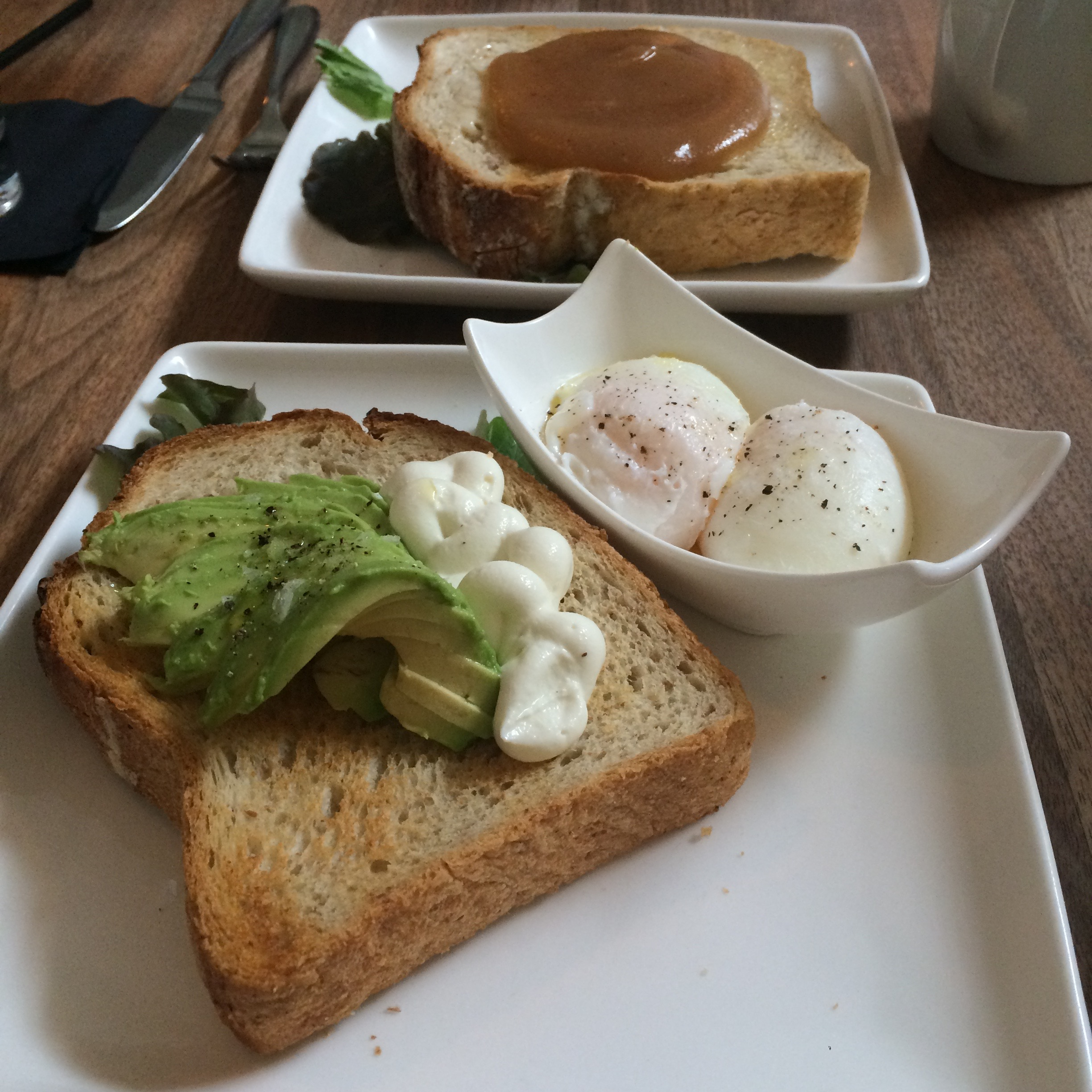 Toast with avocado and goat cheese mousse, side of poached eggs, and toast with apple butter.  (Photo by Arielle Weg)