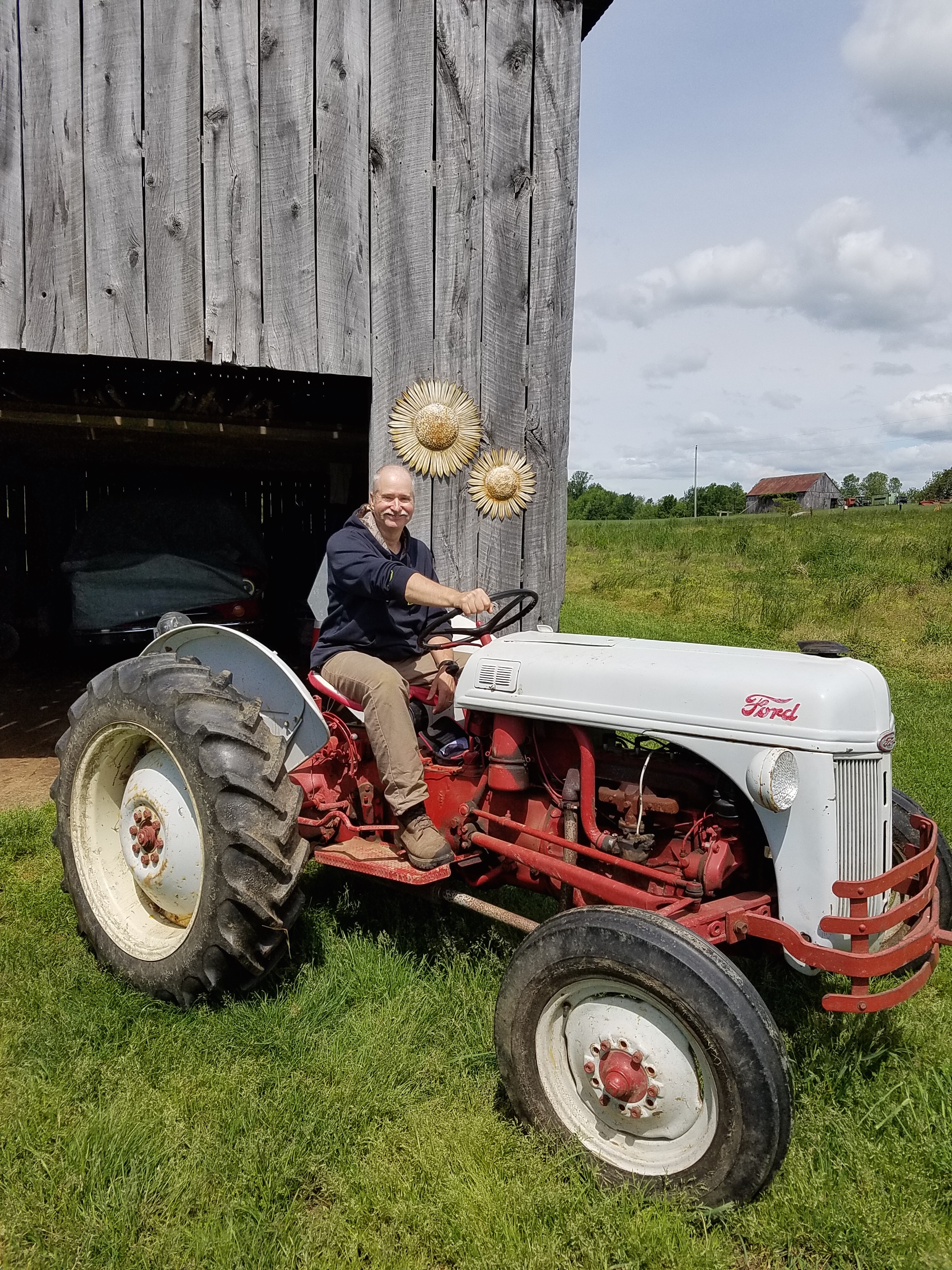 Former firefighter, Gary Palmer, rides his vintage tractor at Holiday memories Farm. (Photo by Susan Able)