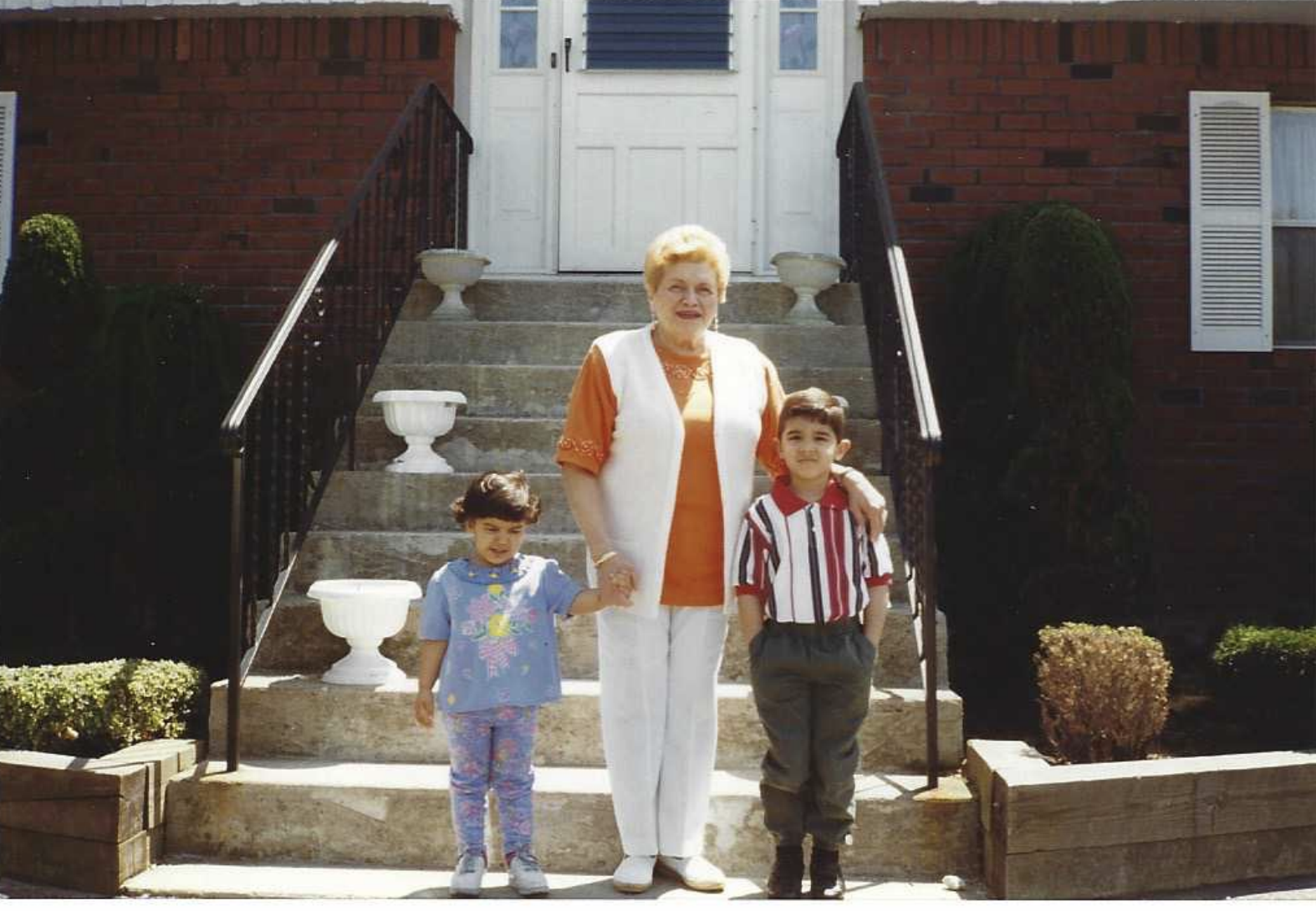 "Young Dan and sister with ""Nanny,"" his grandmother"