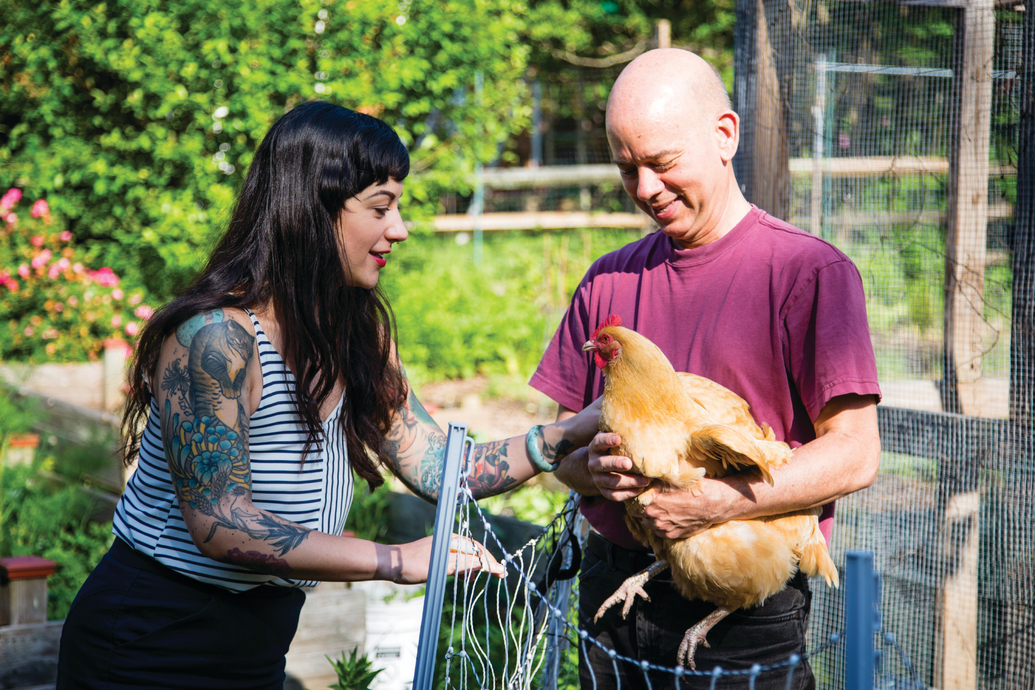 Reana KOvalcik and Ferd hoefner spend time with Little Nettie, Ferd's chicken.