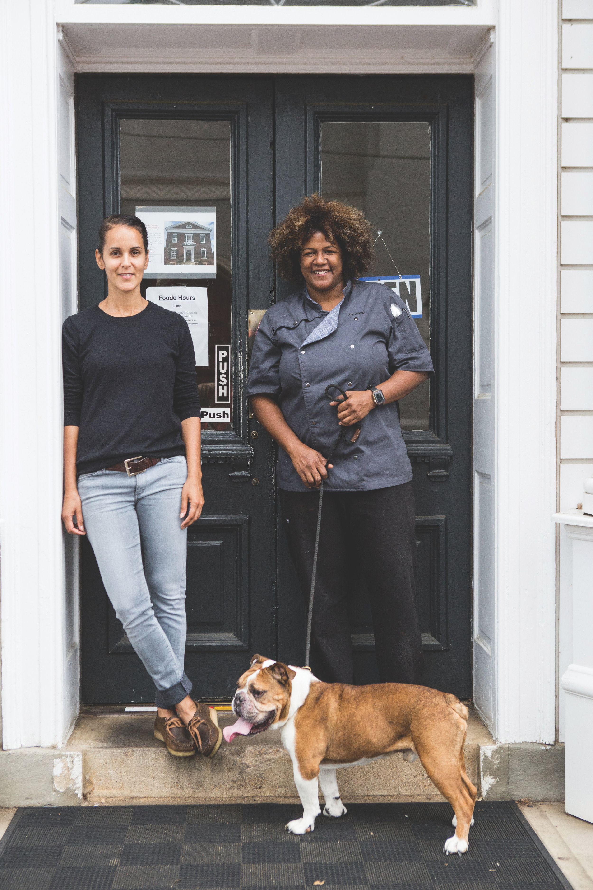 Beth Black, Joy Crump and Chuck, in front of their restaurant