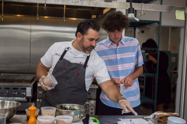 Chef Guas receives help from his son, Kemp, who competed on Top Chef Junior in 2016.