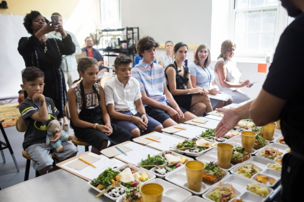 The panel of judges assemble to taste the chefs' redesigned lunches.