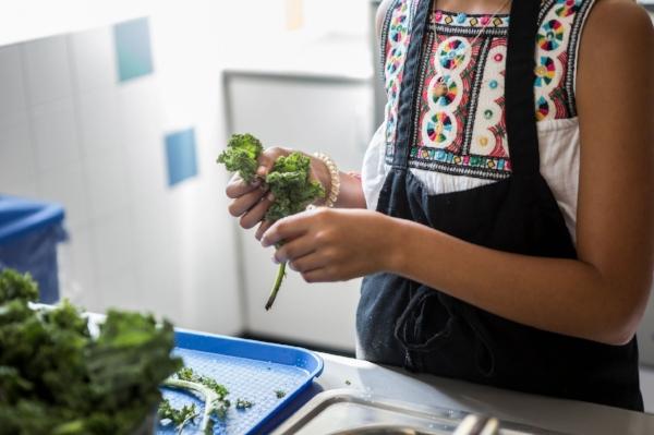 Lucia García helps prepare a kale-and-sweet-potato salad.