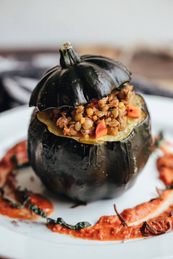 Utilizing local farm produce often results in seasonal dishes, such as this autumn-inspired stuffed gourd.