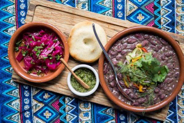 Lobio kotanshi, or red beans stewed with traditional spices, is served with pickled red cabbage and cornbread mchadi.