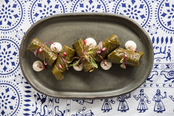 Bostneuli tolma, or grape leaves stuffed with rice, vegetables, and yogurt, make for an excellent opening dish.