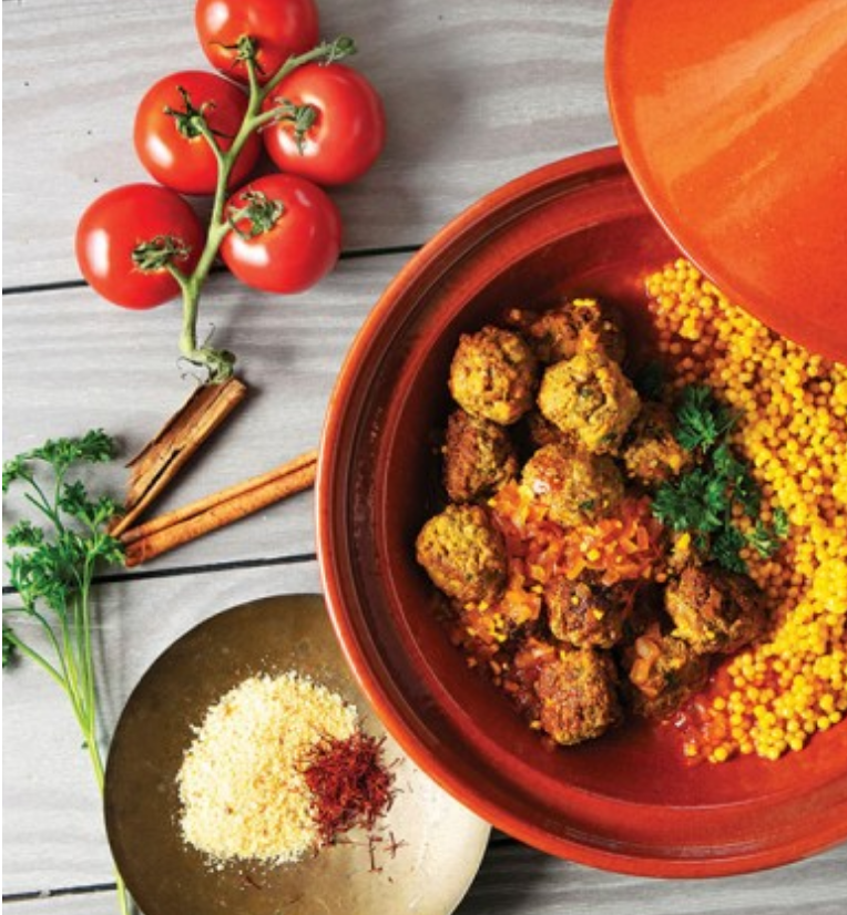 Cooking spiced meatballs in a tagine is both a flavorful and colorful way to ring in the winter holidays.