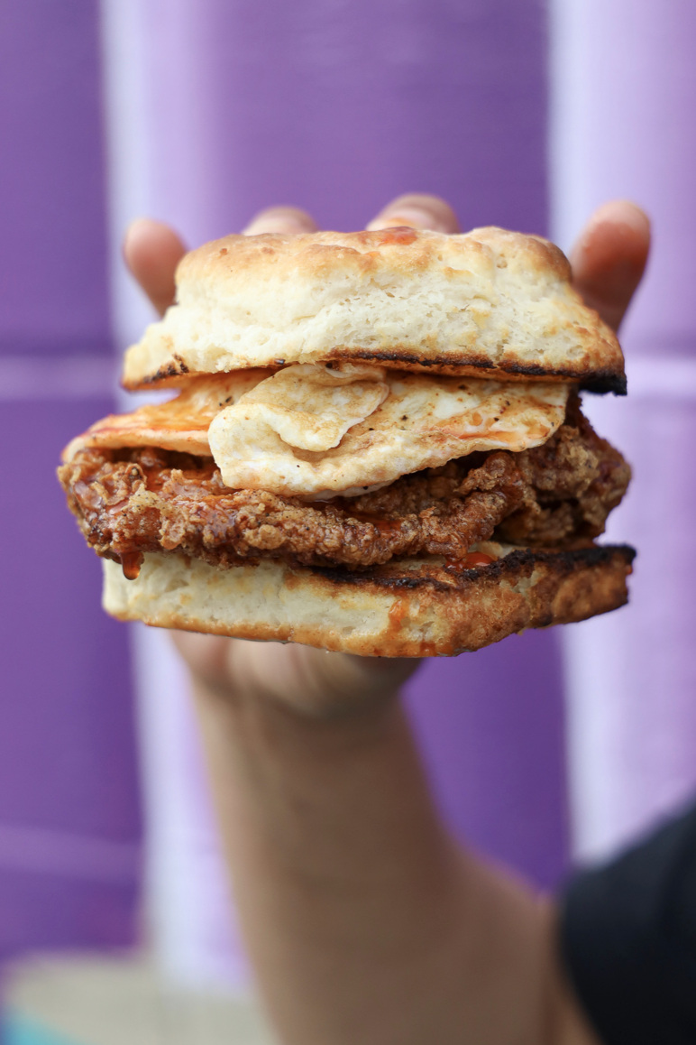 The spicy chicken biscuit sandwich at Bread & Butter Kitchen, topped with an egg.