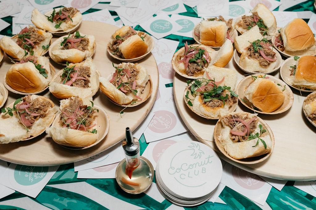 Chef Adam Greenberg serves Kalua Pork Sliders from Coconut Club.