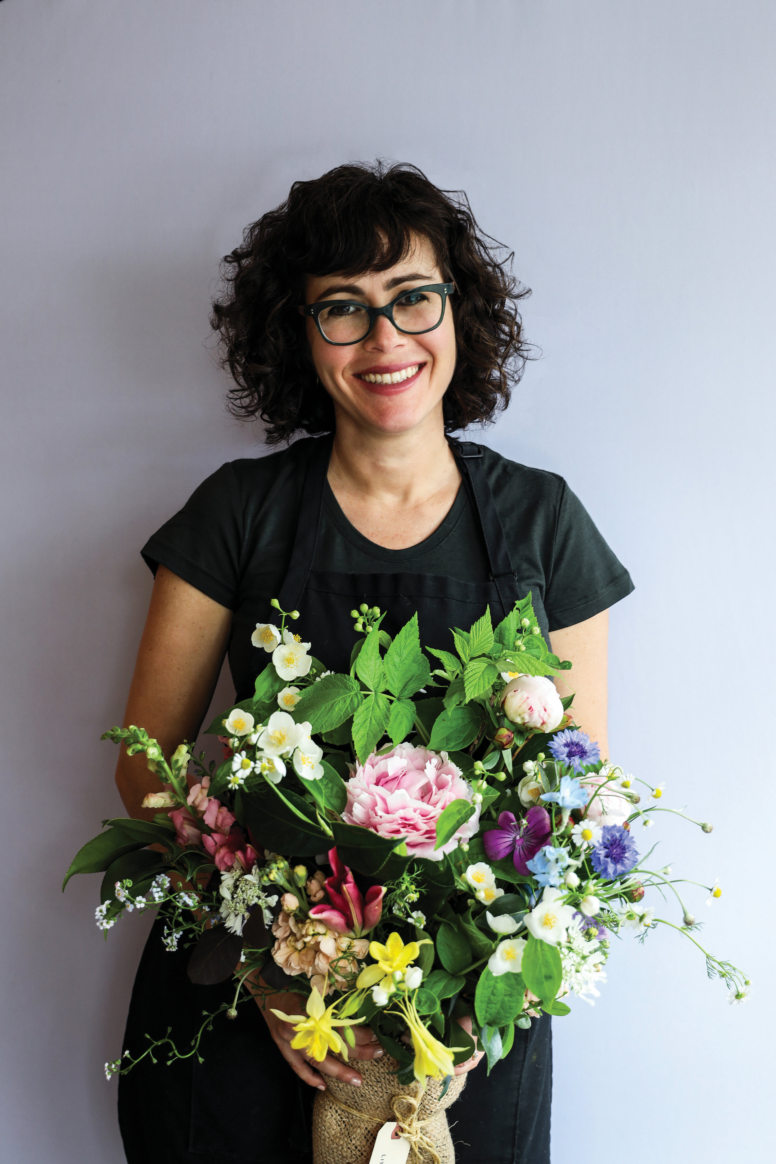Tobie Whitman holds a Little Acre bouquet sourced from only local flowers. Photo by Jennifer Chase.