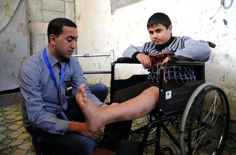 """""""I was playing with my friends when I suddenly felt blood running down me. The next thing I knew, I woke up in a hospital with a great pain in my leg. I was sad seeing my friends going to school and my brothers playing outside in the street, while I could only watch them, unable to run or play football like the others. After the UNRWA teacher started his home visits, I was willing to learn again. In the future, I want to become a dentist, but my biggest dream is to walk to school again."""" -Yousef Mansour, Gaza, April 2015"""