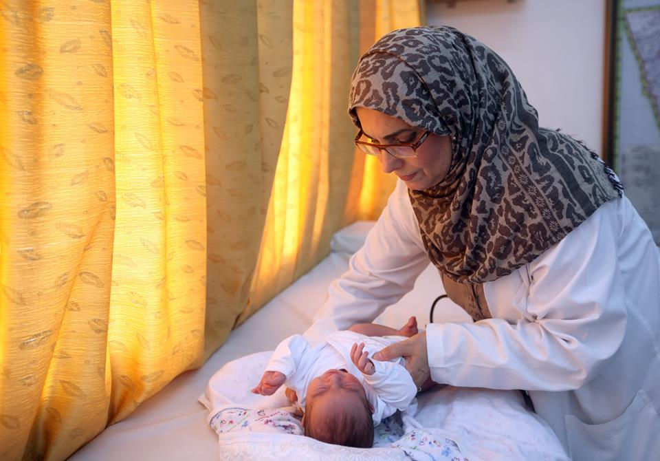"""""""When I left my house, I prayed to God that I can reach the Health Center safely. While at work, I prayed to God to save my family at home. My kids tried to stop me from coming to work every day. Still many patients came to my Health Center, so of course I continued coming to work."""" -Dr. Kefah El Najjar, Gaza, August 2014"""