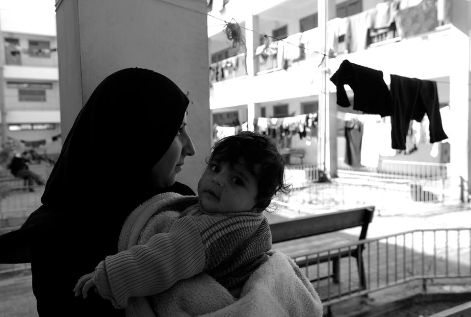 """""""I am everything for these children. My husband could not handle the feeling of helplessness and left me alone with my children. Sometimes, I do not wish to see another sun rise.""""-Felesteen and her baby Suzanne, Gaza, February 2015"""
