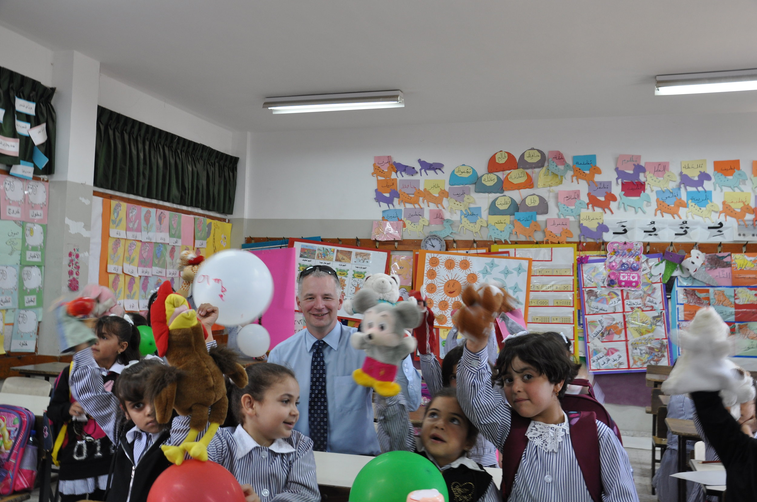 Scott enjoying a day in the classroom with some UNRWA students