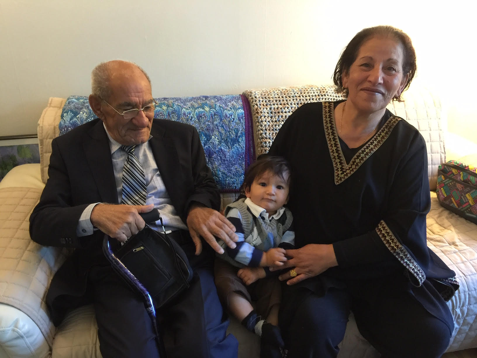 Shadi's mother and father with his oldest son, Sami
