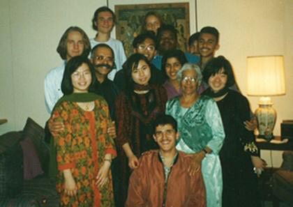 Yassine as a student in Montezuma, NM, surrounded by classmates from around the globe