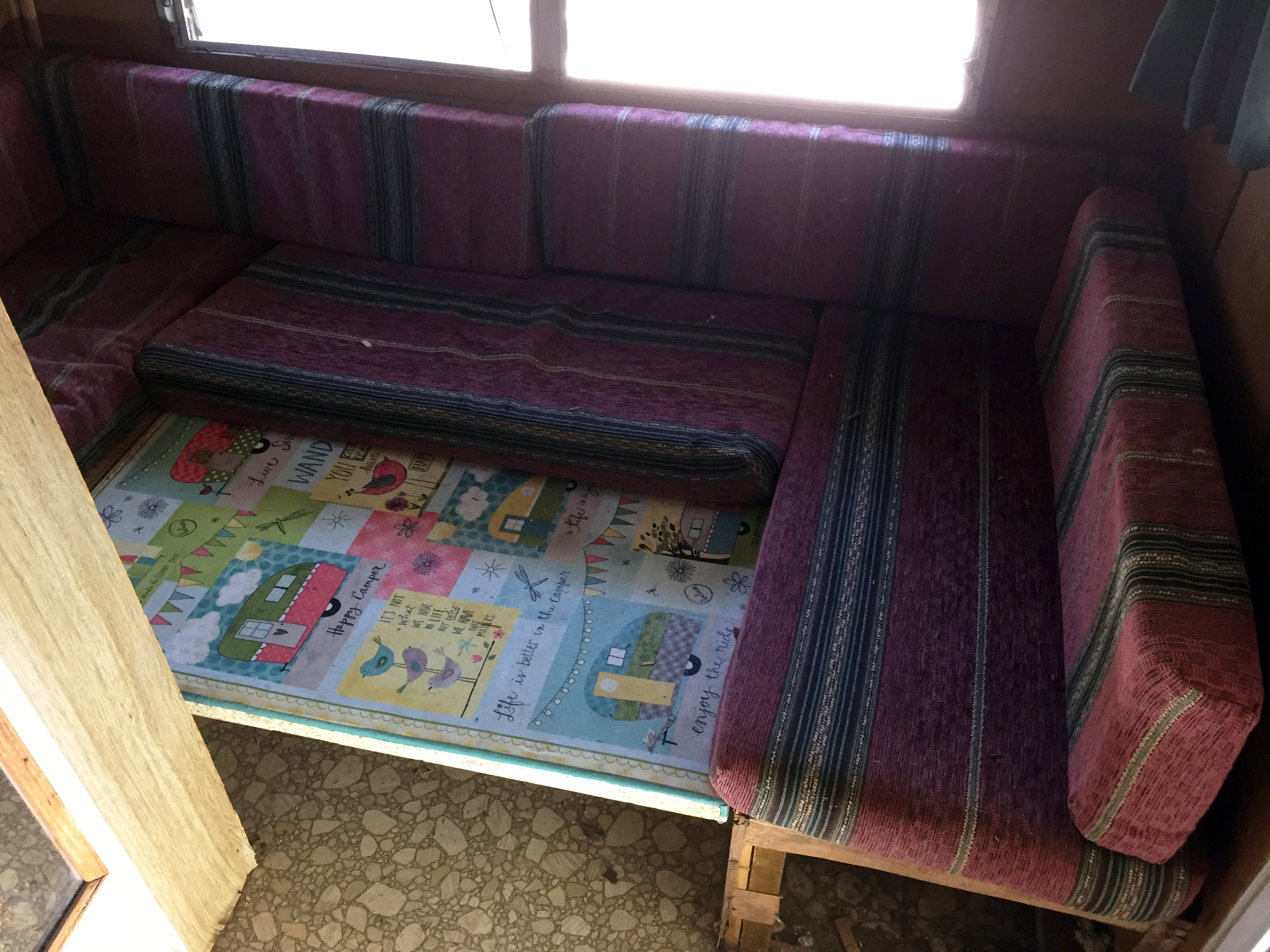 Before —Dinette/Bed Area
