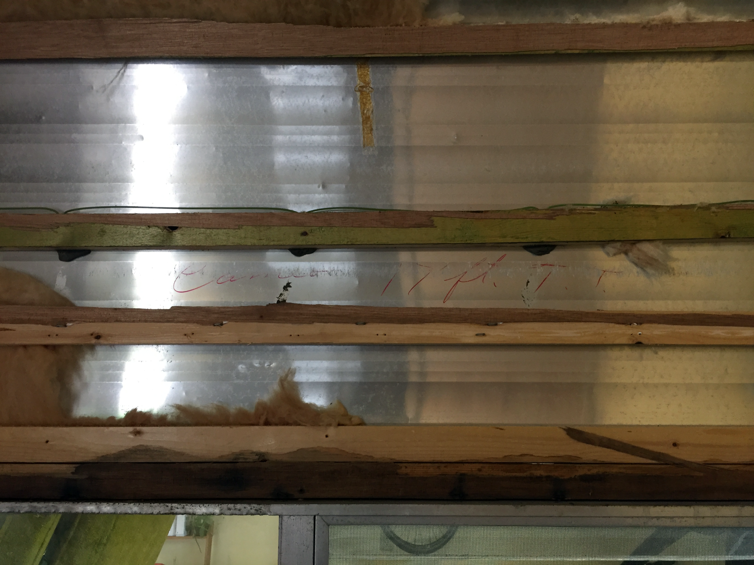 """Original handwriting found above the rear window under the insulation reads  """"Cameo 17 ft. T.T."""",  which I think stands for """"travel trailer""""."""