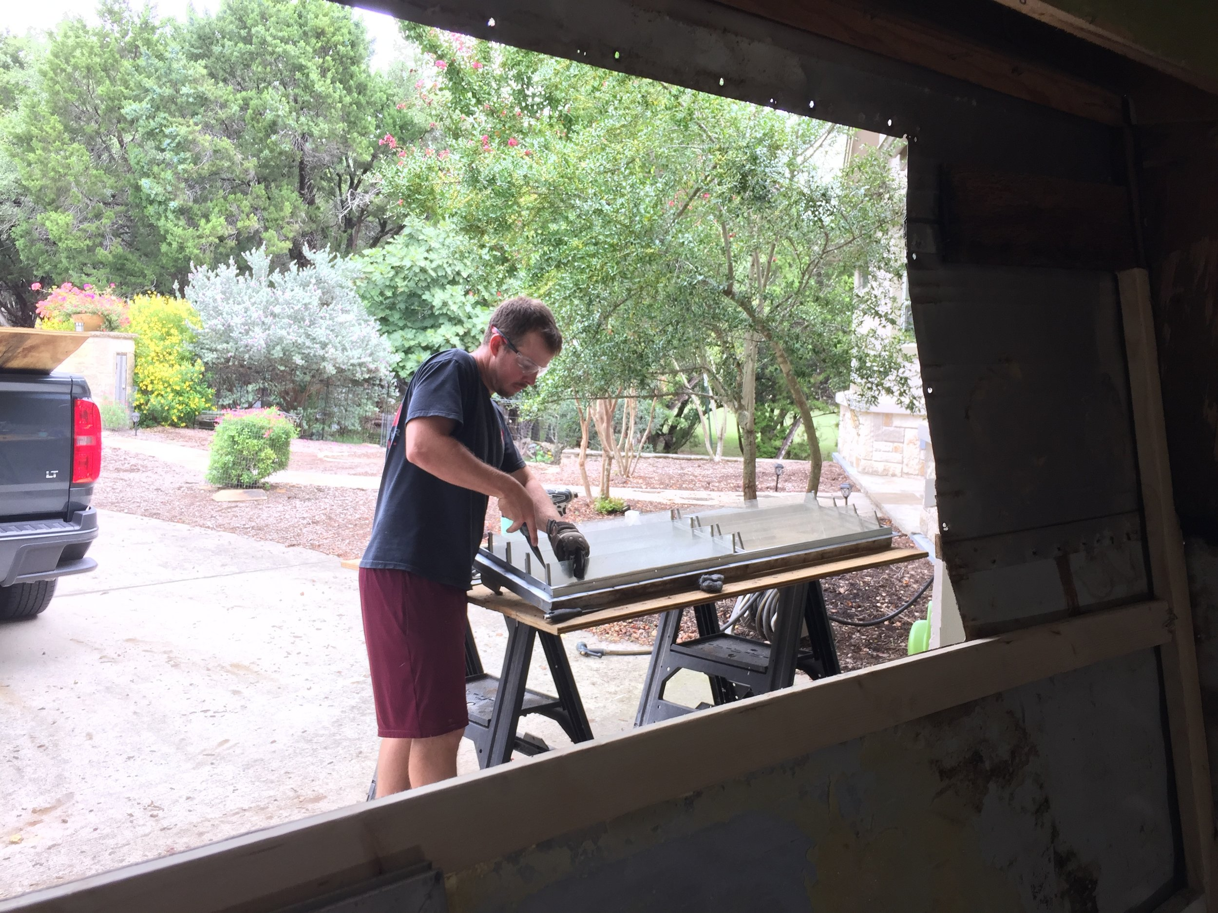 Nick replacing the jalousie glass retainer discs on the large front double window