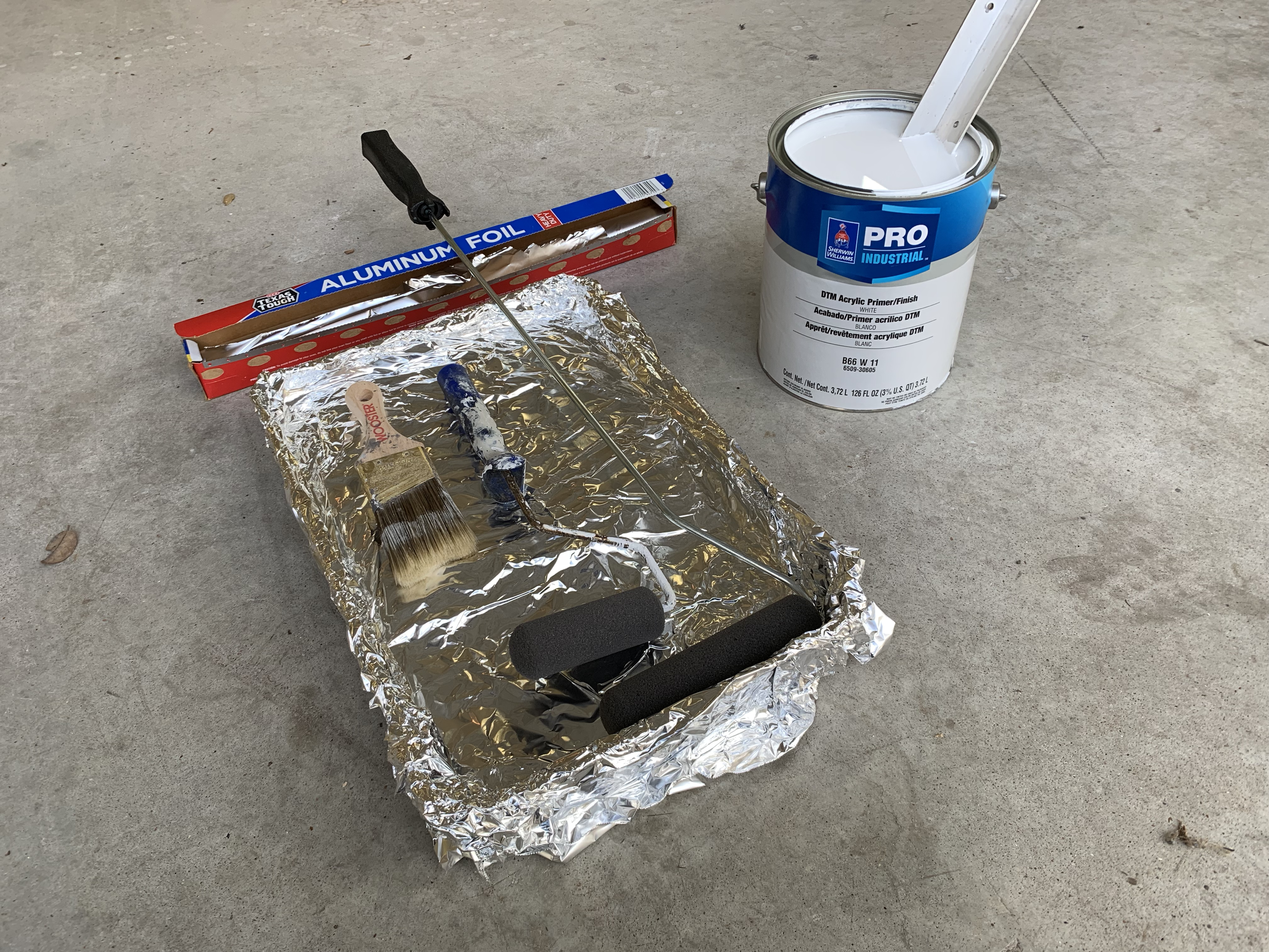 Primer supplies – Sherwin Williams DTM Acrylic Primer/Finish, foam rollers, oil paint brush, rolling tray with aluminum foil