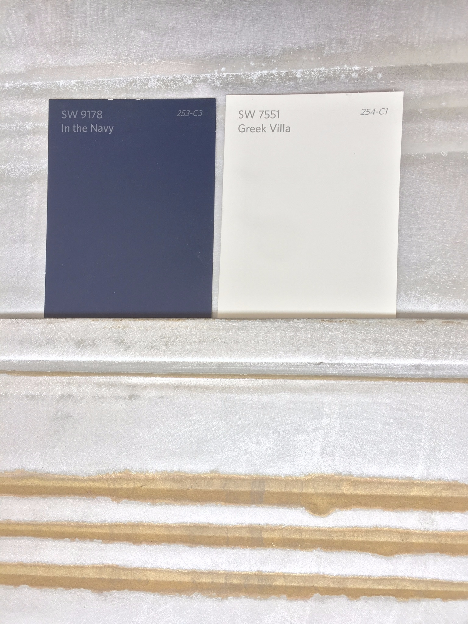 When we were picking out our exterior paint colors. Love this color combo of navy, off-white, silver and just a touch of gold!