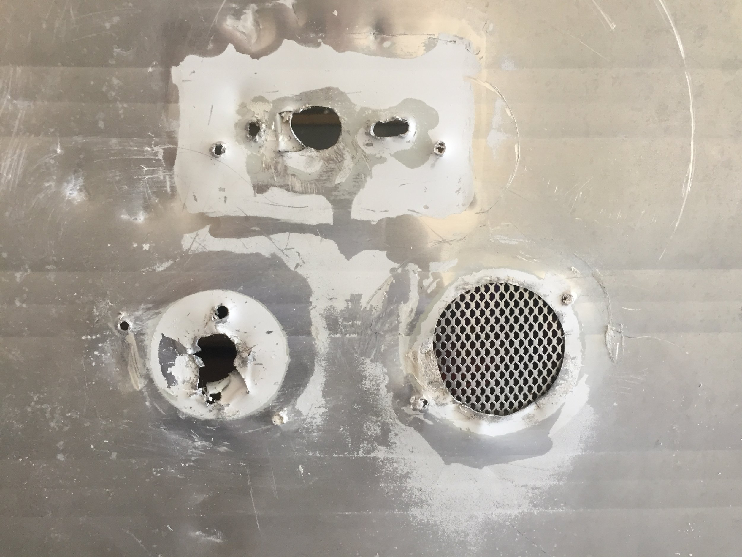 Large holes – the one on the right is shown with the Bondo self adhesive patch in place behind it.