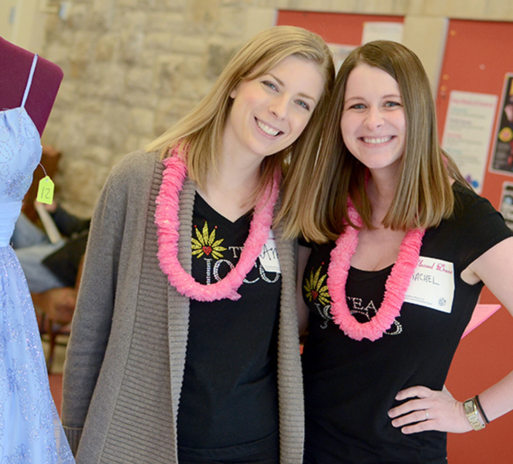 Volunteers Welcome Guests to Boutique