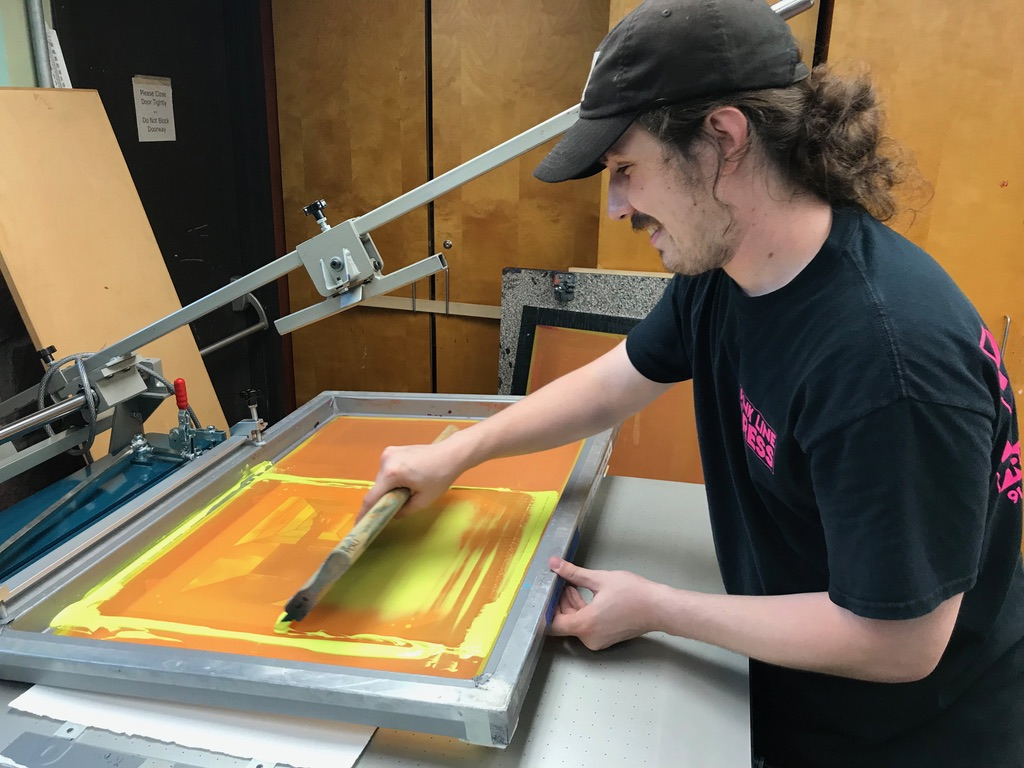Studio Manager Mike Stark pulling a screen print for a series of 12 fine art prints by artist Lev Gal Wertman for the Gottesman RTW Academy.