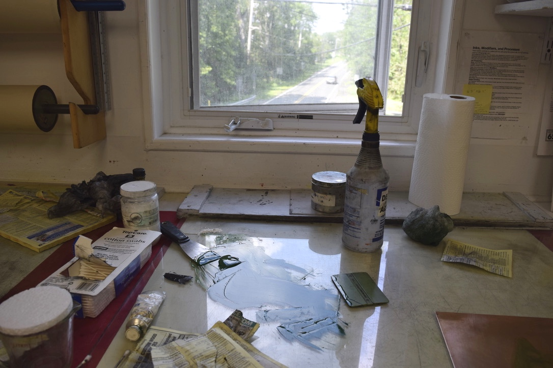 An image of someone's workspace at the Frontline Arts studio
