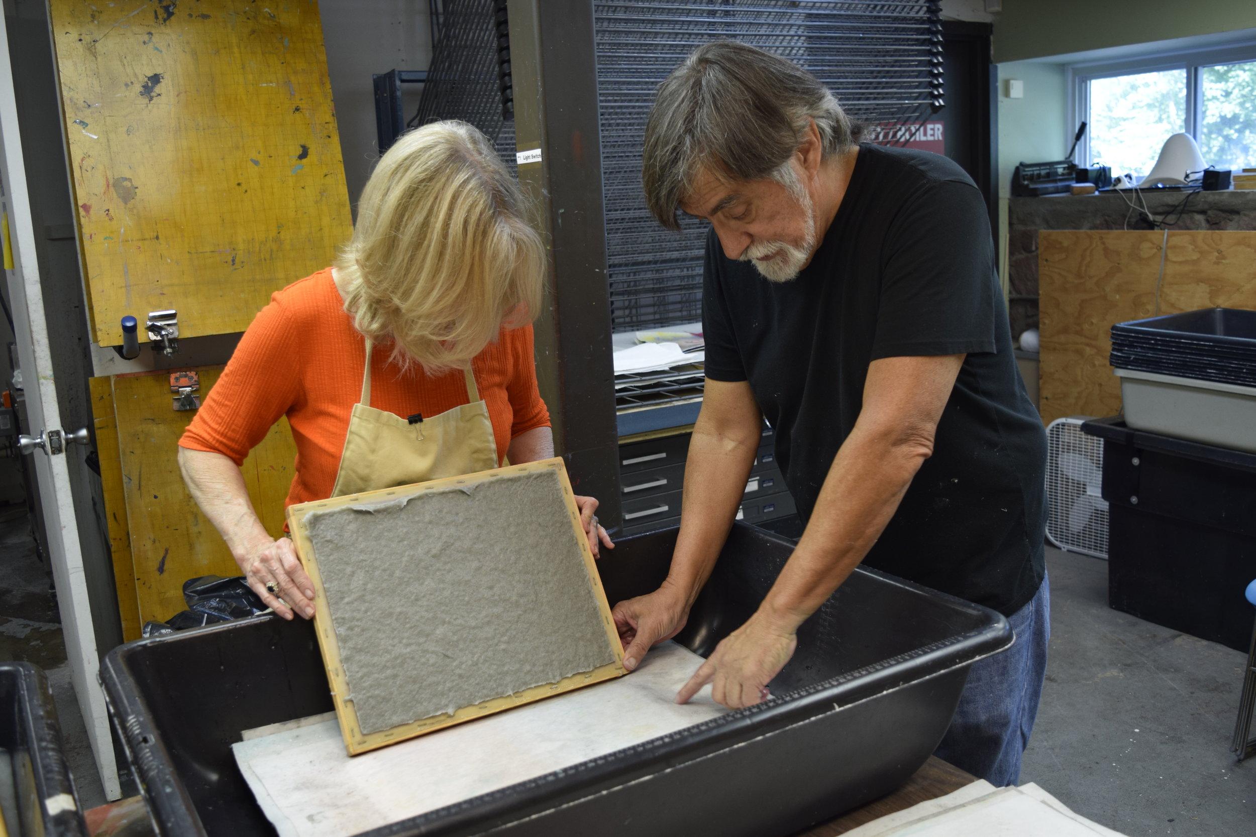 Walt Nygard teaching non-veterans how to make handmade paper from military uniforms