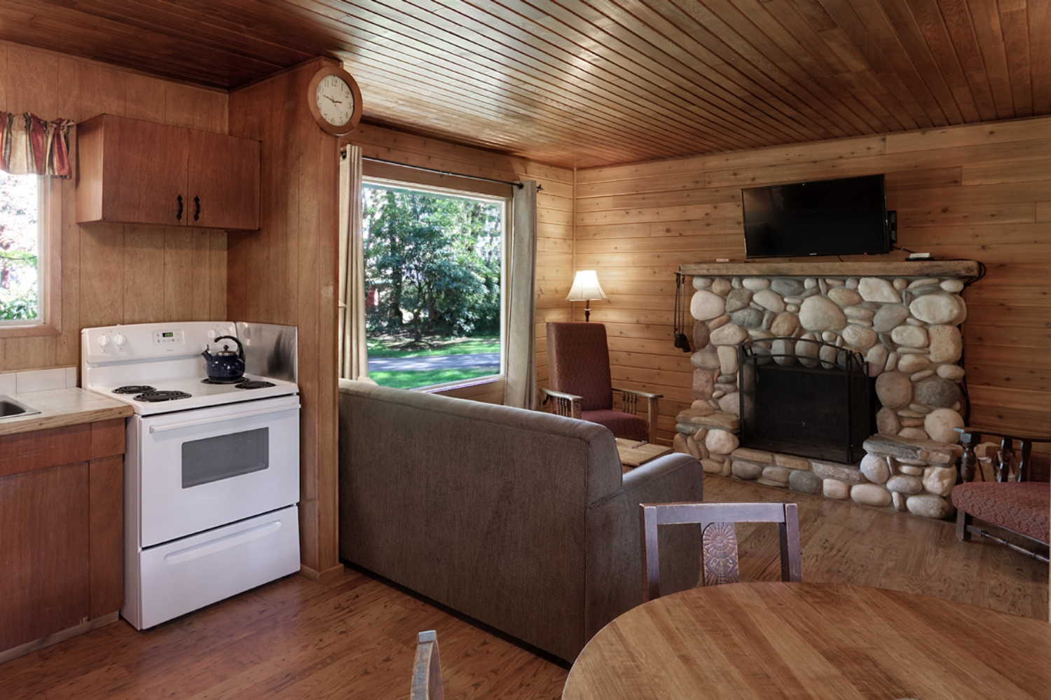 CABIN 9 - Two Bedrooms  Tucked away in the garden featuring a beautiful river-rock fireplace. From $189-$245