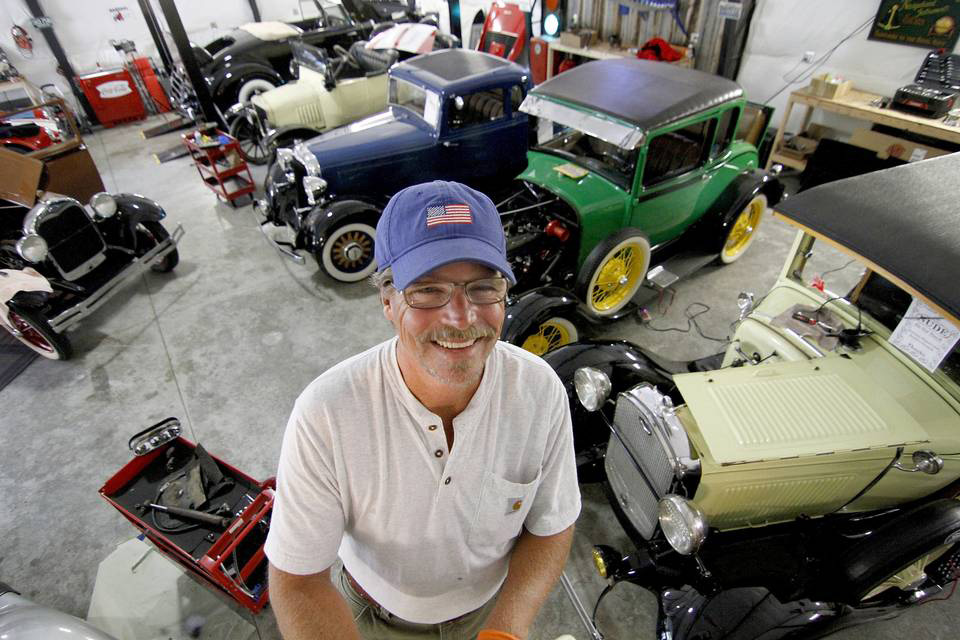 Jim Sullivan shows off his garage, where he restores classic cars. Sullivan specializes in cars from before 1970.     LEE GILES III  - Staff photographer