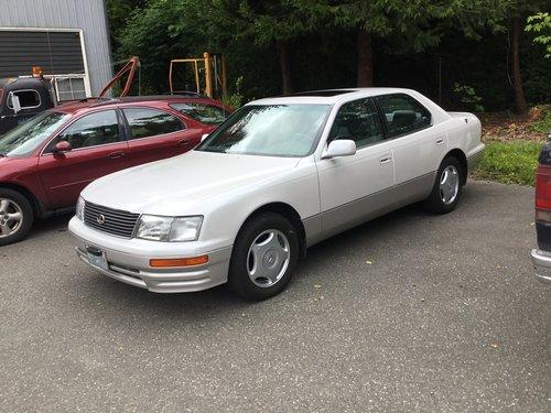 "1997 Lexus SL 400<div class=""sold"">SOLD</div>"