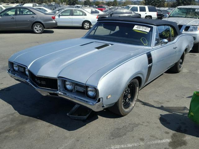 "1968 Oldsmobile Cutlass Convertible<div class=""sold"">SOLD</div>"