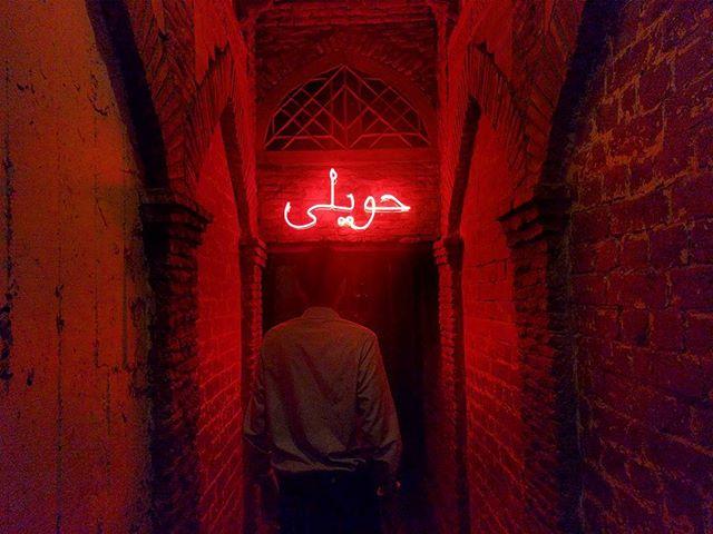 Red Light. . . . . . #haveli #pakistan #red #light #neon #bricks #history #hall #architecture #dinner #walk #arch #lahore