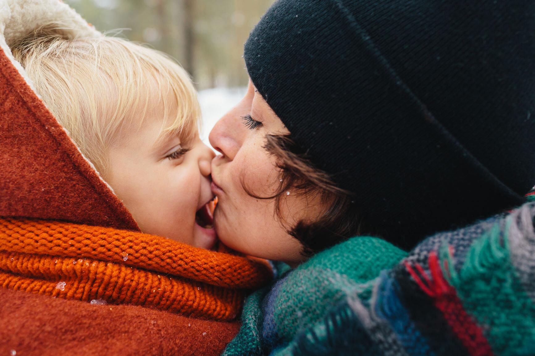 Mom kissing son.jpg