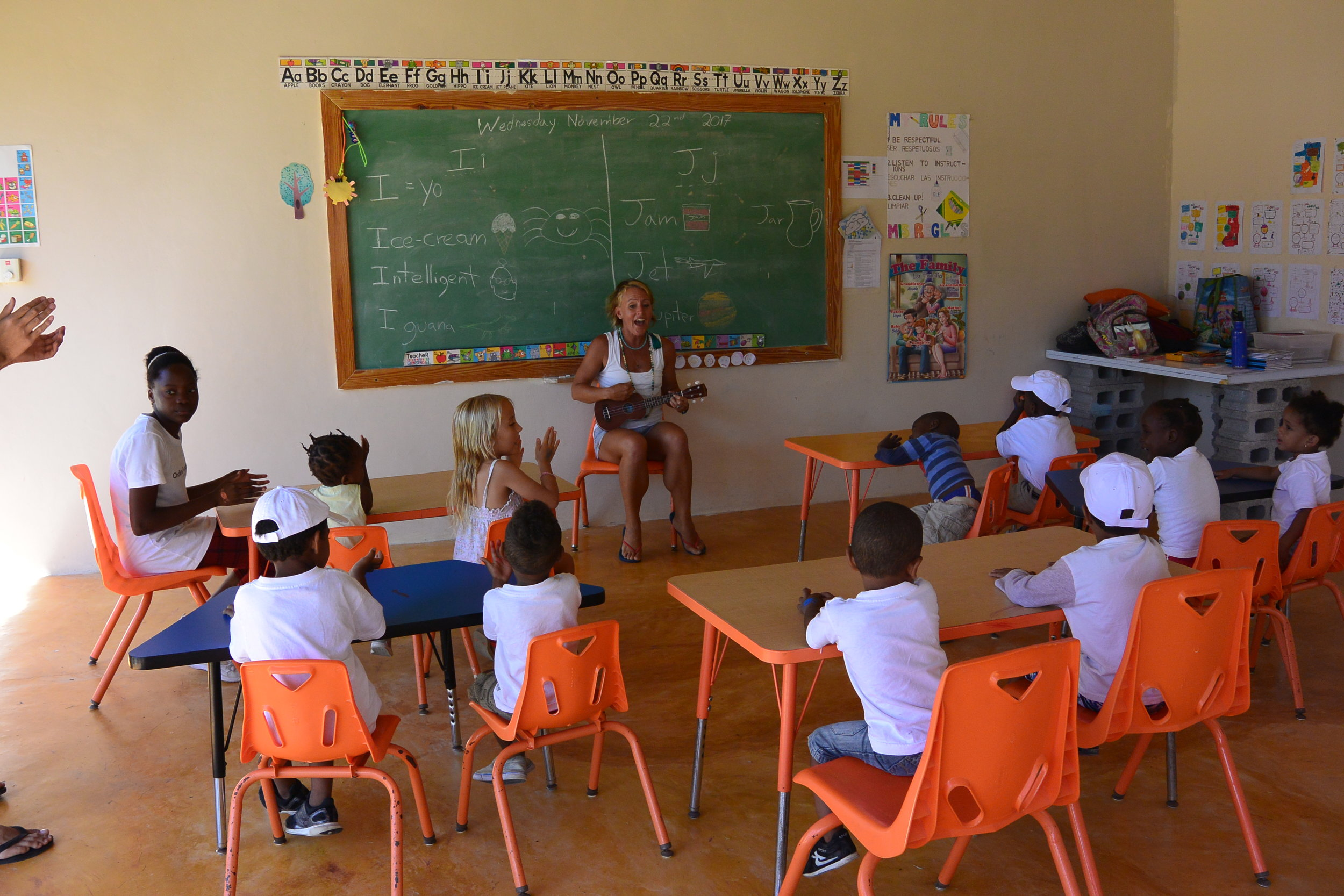 """Playing the uke and singing the """"Hello"""" song- how we begin each class."""
