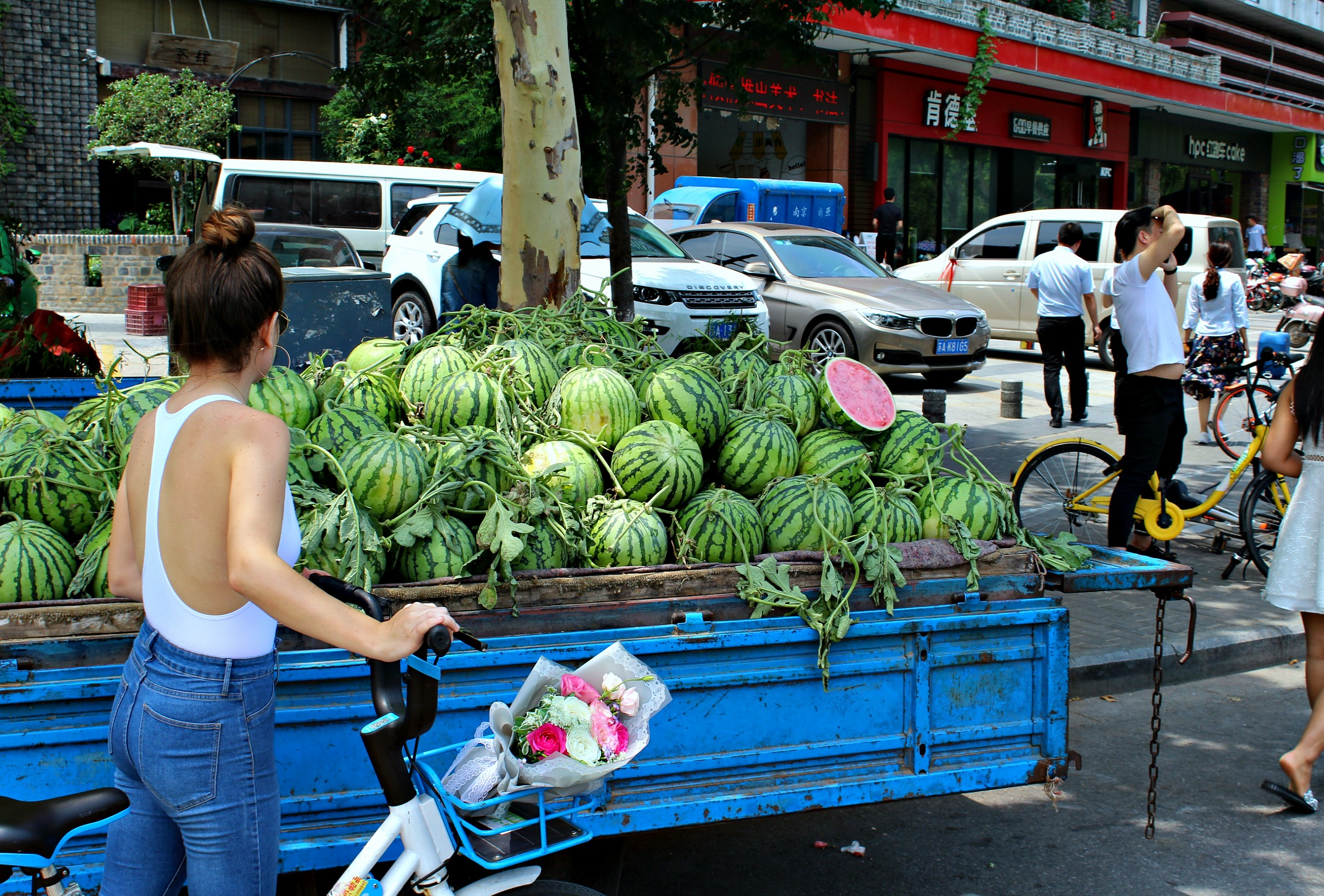 buying watermelon from the local watermelon truck outside my flat