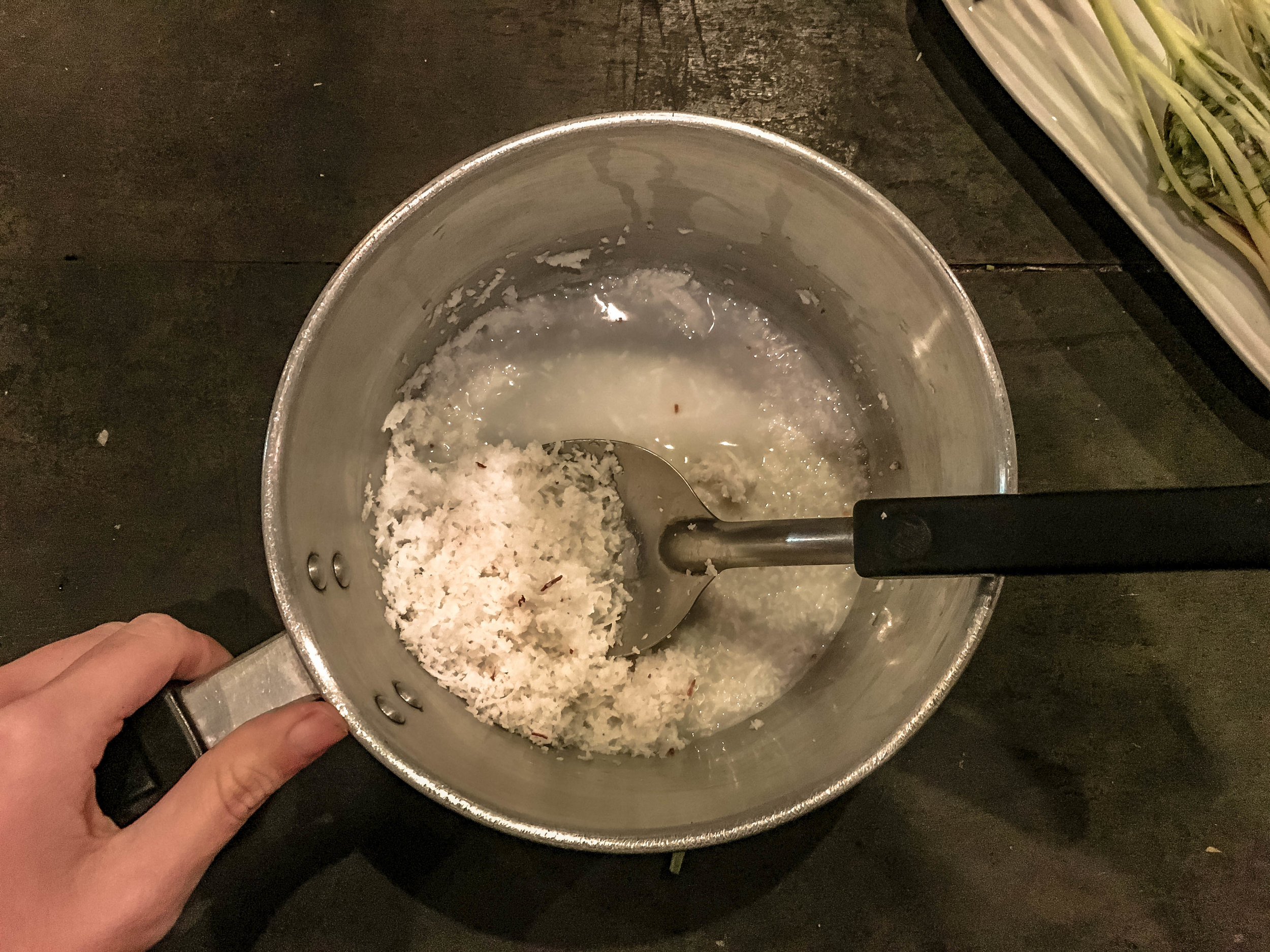 MIXING SHREDDED COCONUT WITH HOT WATER TO CREATE OUR OWN COCONUT MILK