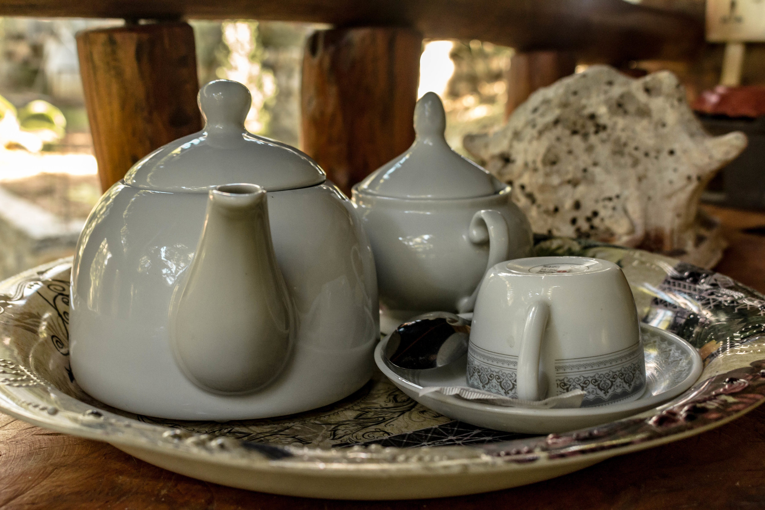 TEA IS BROUGHT TO YOU AT THE START AND END OF EACH DAY, AND BEFORE AND AFTER YOUR SAFARI {IF YOU GO ON ONE} AT THE WOODEN HUT