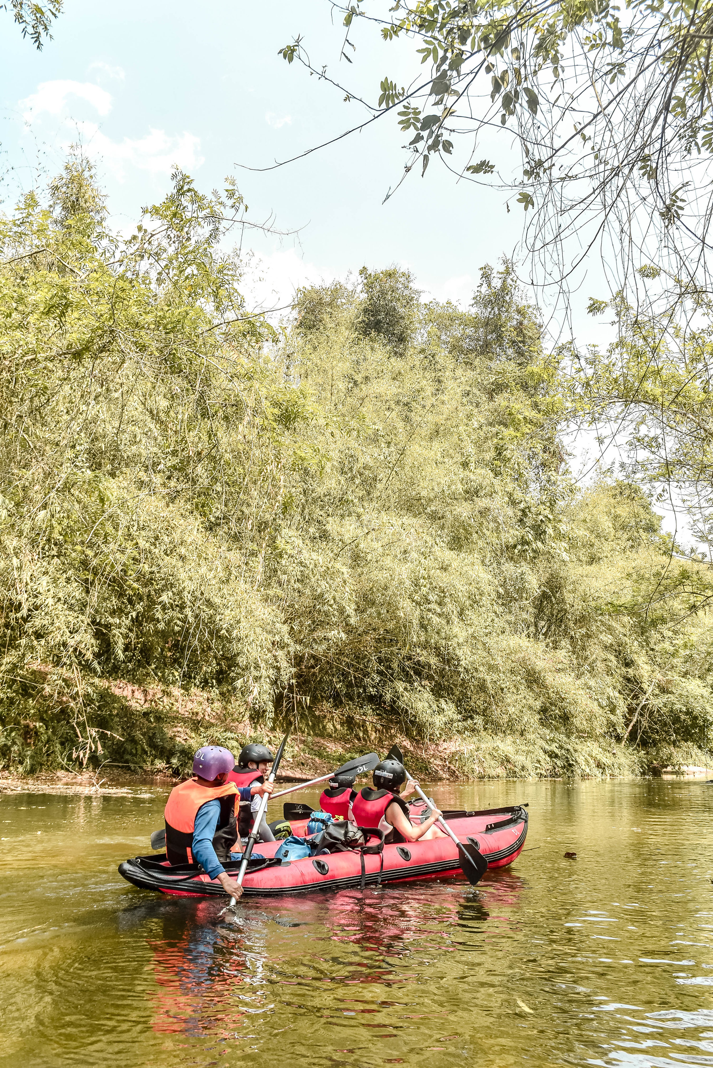 Kayaking the Nam Ha River in the northern part of Laos is a scenic escape for intrepid travelers looking for off-the-beaten path adventures that bring them back to nature.